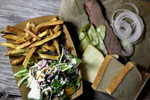 Brisket plate with a salad and fries from Alamo Smoke