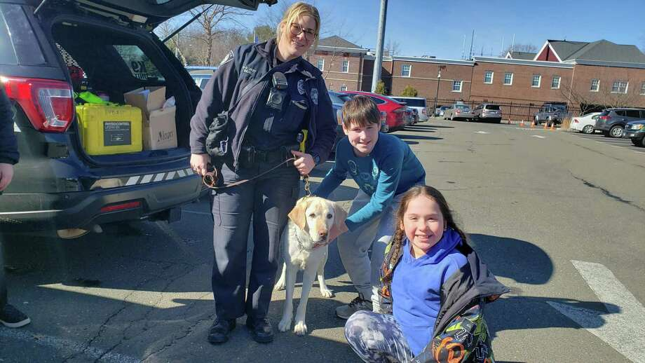 Willow Buscemi with her children, Serafina and Jack. The special guest was K-9 Kenny, owned by handler and Darien Police Officer Leslie Silva. Photo: Sandra Diamond Fox / Hearst Connecticut Media / Connecticut Post