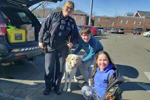 Willow Buscemi with her children, Serafina and Jack. The special guest was K-9 Kenny, owned by handler and Darien Police Officer Leslie Silva.