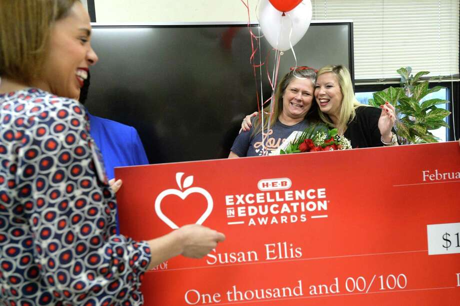 Central Middle School science teacher Susan Ellis (center) gets a hug from principal Natalie Gomez as she is surprised by H-E-B's Lacey Dalcour Salas with the news that she won an H-E-B state-wide Excellence in Education Award and is presented with a check for $1,000 in her classroom Tuesday morning. H-E-B will match the award with a $1,000 grant to the school, as well. Ellis will go on to compete in the grandprize round, with the award of $25,000. Among the 30 schools across Texas to win, Ellis was the sole winner from the Southeast Texas region this year. Photo taken Tuesday, February 18, 2020 Kim Brent/The Enterprise Photo: Kim Brent / The Enterprise / BEN