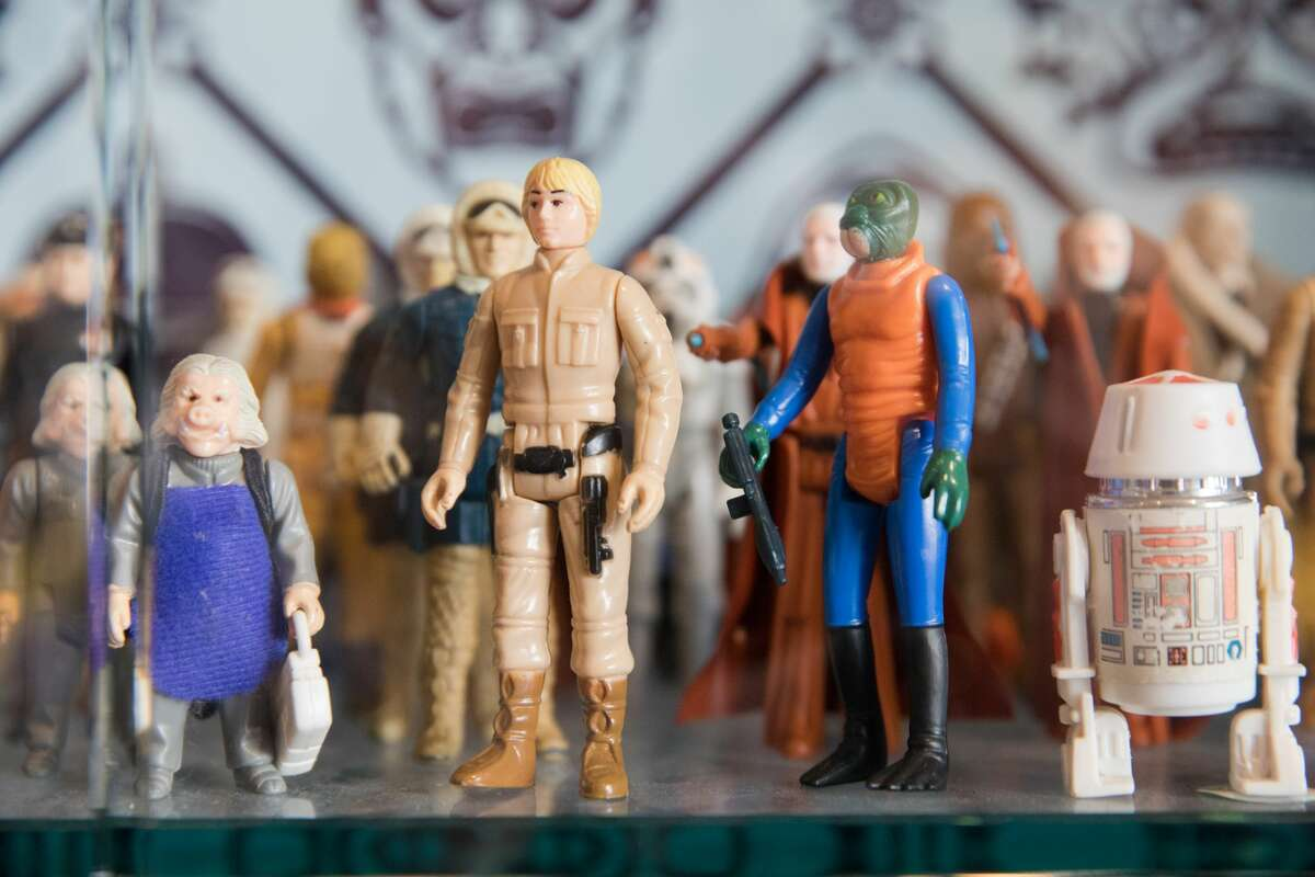 Old Star Wars action figures are on display and for sale at Super7 pictured in this Feb. 14, 2020 photo. It is a toy store that redesigns vintage action figures from the '80s and '90s and also has a large selection of vintage-inspired T-shirts.