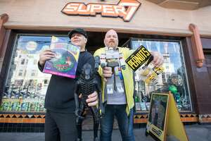 (Right to left)Brent Dinsdale and Daniel Sant work at Super7 toy store in the Mission District. The store redesigns vintage action figures from the '80s and '90s and also has a large selection of vintage-inspired T-shirts.