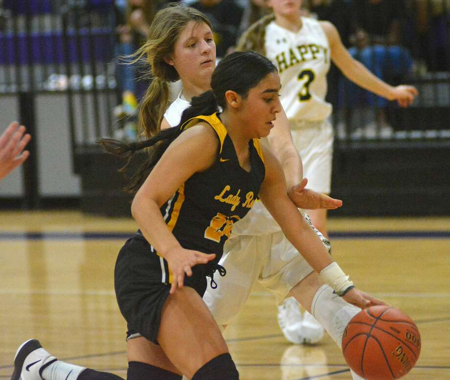 Kress' Aaliyah Lopez dribbles past a Happy defender during their Class 1A bi-district girls basketball game on Monday, Feb. 17, 2020 at Canyon High School. Photo: Nathan Giese/Planview Herald