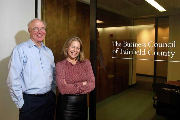 Erin Flynn, the new CEO-president of the Business Council of Fairfield County, poses with Chris Bruhl at the Business Council of Fairfield County's offices at Landmark Square in downtown Stamford, Conn., on Thursday, Feb. 6, 2020. Flynn took over the organization's top position from Bruhl, who retired at the end of January after 30 years in the position.