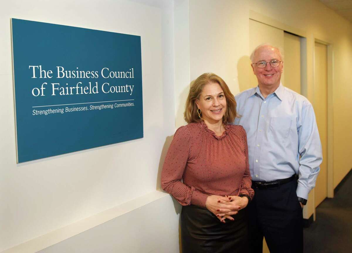 New President and CEO of the Business Council of Fairfield County Erin Flynn poses with predecessor Chris Bruhl at the Business Council of Fairfield County's main offices at Landmark Square in downtown Stamford, Conn., on Feb. 6, 2020. Flynn took over the role of President and CEO from Bruhl, who retired at the end of January after 30 years in the position.