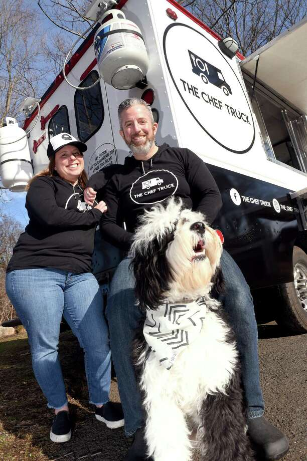 Missy Miller and John Kronfeld are photographed with their dog, Monti, a Burnese Mountain Dog/Poodle mix, at their food truck, The Chef Truck, behind their home in Branford on February 17, 2020. Photo: Arnold Gold / Hearst Connecticut Media / New Haven Register