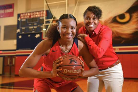 Atascocita senior post Elyssa Coleman was named district MVP this week.   Here, she poses with girls basketball coach Veronica Johnson in the AHS gym on Jan. 6, 2020.