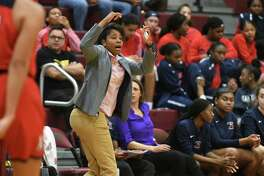 Atascocita Head Girls Basketball Coach Veronica Johnson, center, leads her team against Summer Creek in the 2nd quarter of their District 22-6A matchup at Summer Creek High School on Friday, Jan. 3, 2020.