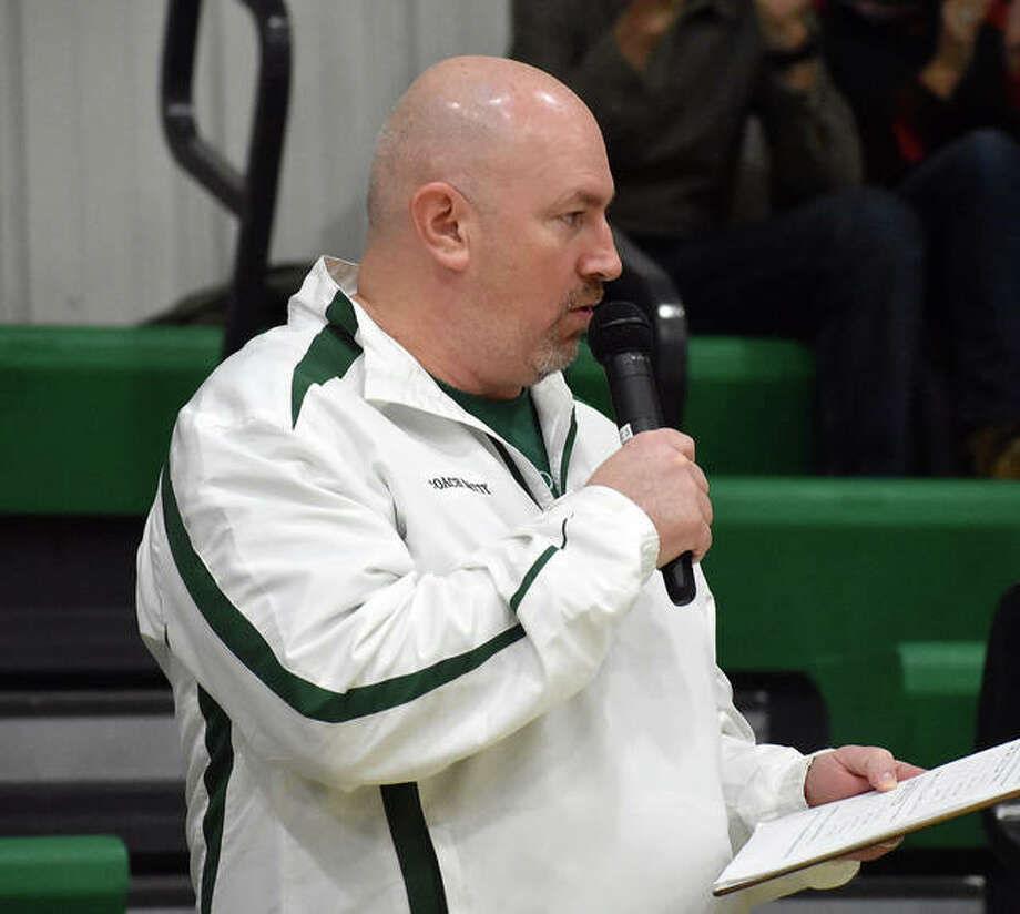 Metro-East Lutheran athletic director Jason Batty introduces line-ups before the start of a girls basketball game inside Thomas Hooks Gymnasium in Edwardsville.