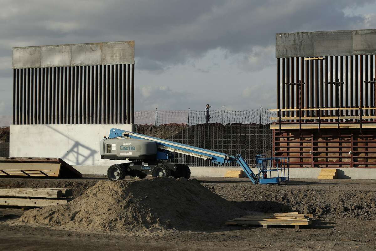 FILE - In this Nov. 7, 2019 file photo, the first panels of levee border wall are seen at a construction site along the U.S.-Mexico border, in Donna, Texas. The Trump administration said Tuesday, Feb. 18, 2020, that it will waive federal contracting laws to speed construction of the border wall with Mexico. (AP Photo/Eric Gay, File)