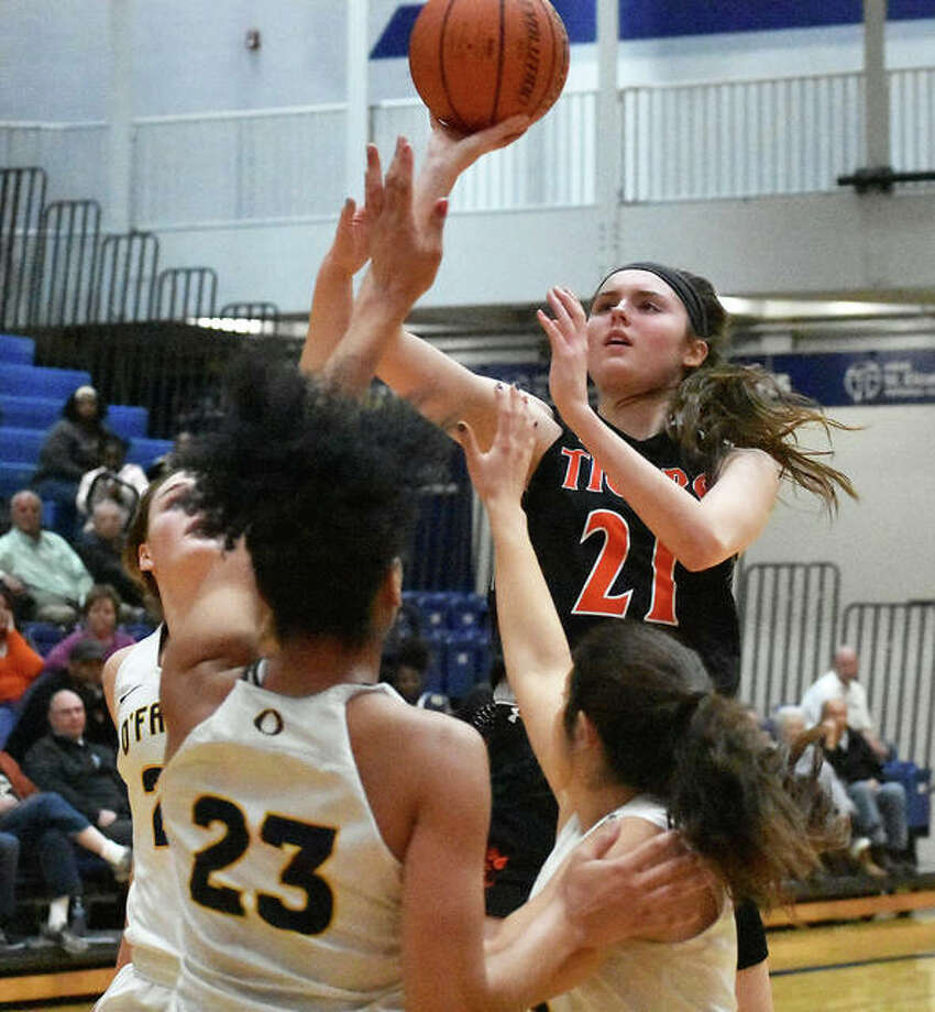 Edwardsville sophomore forward Elle Evans puts up a runner in the lane during the first half against O'Fallon. Photo: Matt Kamp|The Intelligencer