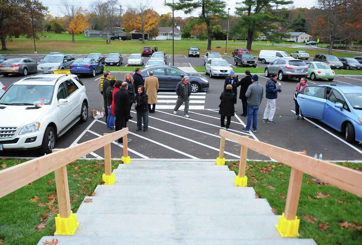 Democrats and republicans greet voters at the polling place at Madison Middle School in Trumbull, Conn. on Tuesday Nov. 7, 2017.