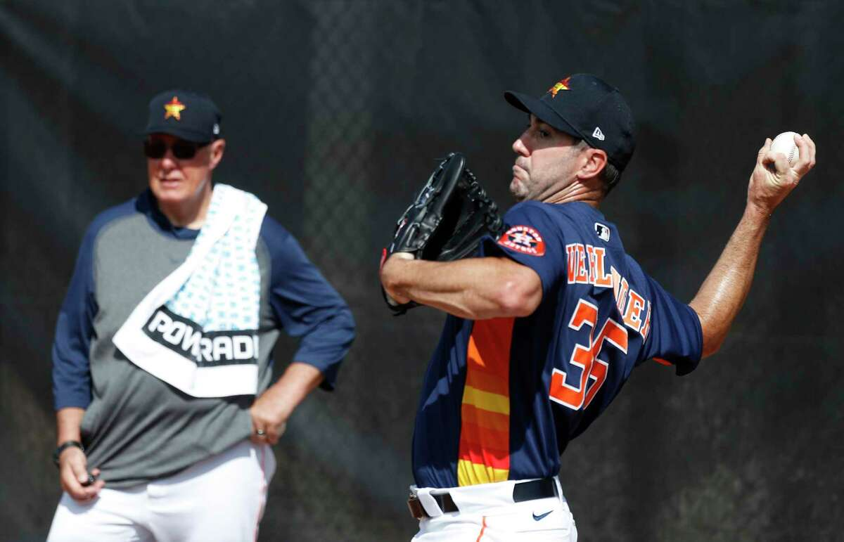 Houston Astros pitcher Justin Verlander (35) pitches as pitching coach Brent Strom watches during the Houston Astros spring training workouts at the Fitteam Ballpark of The Palm Beaches, in West Palm Beach , Tuesday, Feb. 18, 2020.