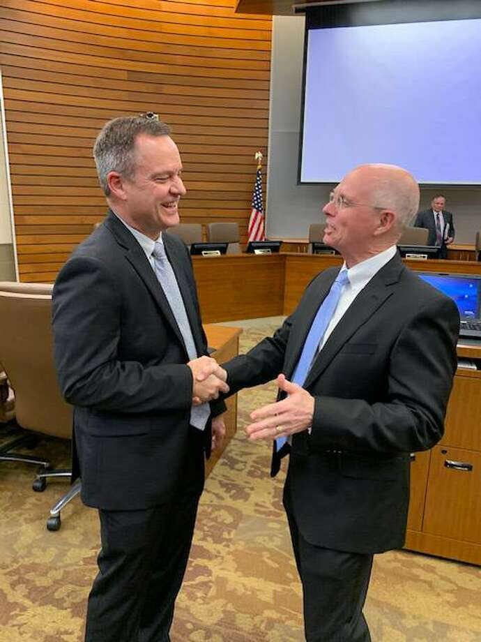 Deer Park ISD's next superintendent, Stephen Harrell, left, is congratulated by current superintendent Victor White after district trustees approved Harrell as next superintendent after White retires in August. White coached, taught and mentored Harrell.