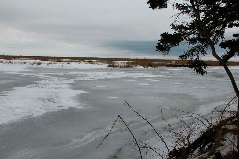 The Sebewaing River frozen during the winter. Efforts to prevent the river from flooding may get funding through the federal budget. (Robert Creenan/Huron Daily Tribune)