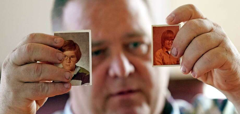 In this Thursday, Feb. 13, 2020, photo, James Kretschmer holds photographs of himself at age 11 and 12 during an interview in Houston. The Boy Scouts of America has filed for bankruptcy protection as it faces a barrage of new sex-abuse lawsuits. The filing Tuesday, Feb. 18, in Wilmington, Del., is an attempt to work out a potentially mammoth compensation plan for abuse victims that will allow the 110-year-old organization to carry on. Kretschmer of Houston, among the many men suing for alleged abuse, says he was molested by a Scout leader over several months in the mid-1970s in the Spokane, Washington, area. (AP Photo/David J. Phillip) / Copyright 2020 The Associated Press. All rights reserved.