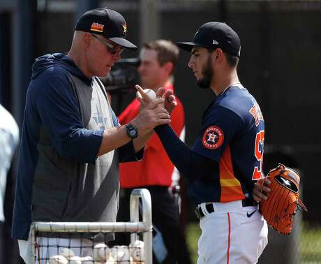 Houston Astros pitching coach Brent Strom (56) works with pitcher Cionel Pérez (52) during the Houston Astros spring training workouts at the Fitteam Ballpark of The Palm Beaches, in West Palm Beach , Tuesday, Feb. 18, 2020.