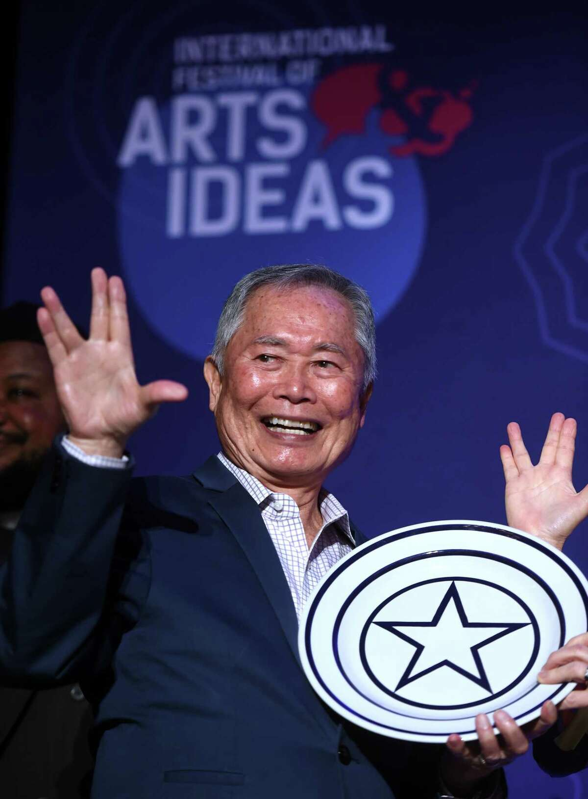 Actor and activist George Takei flashes the Vulcan salute after receiving the Visionary Leadership Award by the International Festival of Arts & Ideas at the Omni New Haven Hotel at Yale on February 18, 2020. The award honors a person whose work impacts the world.