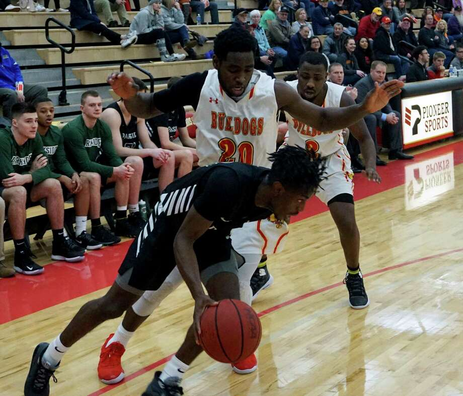 Ferris State junior wing Dorian Aluyi guards an opponent at Wink Arena during GLIAC action. (Pioneer file photo/Joe Judd)