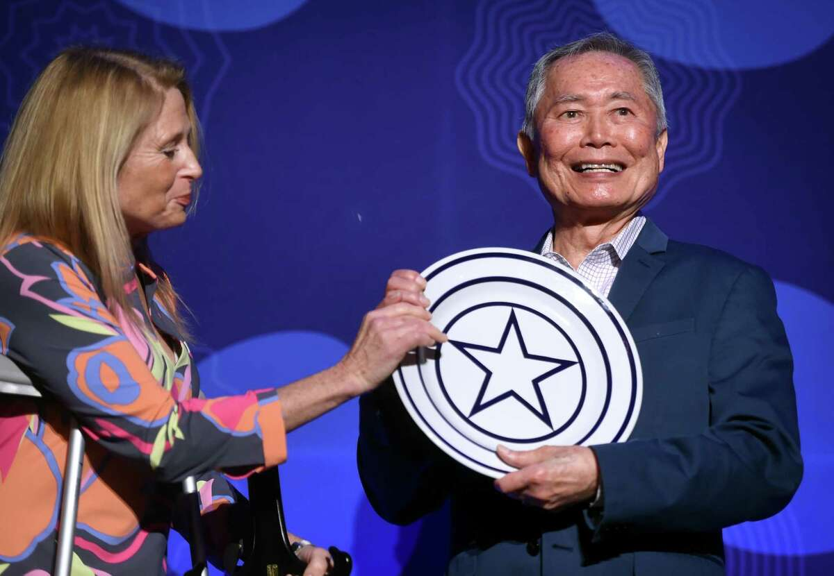Actor and activist George Takei receives the Visionary Leadership Award by the International Festival of Arts & Ideas from board member Dr. Kiki Kennedy at the Omni New Haven Hotel at Yale on February 18, 2020. The award honors a person whose work impacts the world.