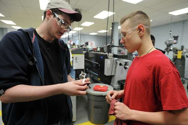 Bassick High School students enrolled in the advanced manufacturing program at Housatonic Community College in Bridgeport, Conn. on Thursday, April 28, 2016.