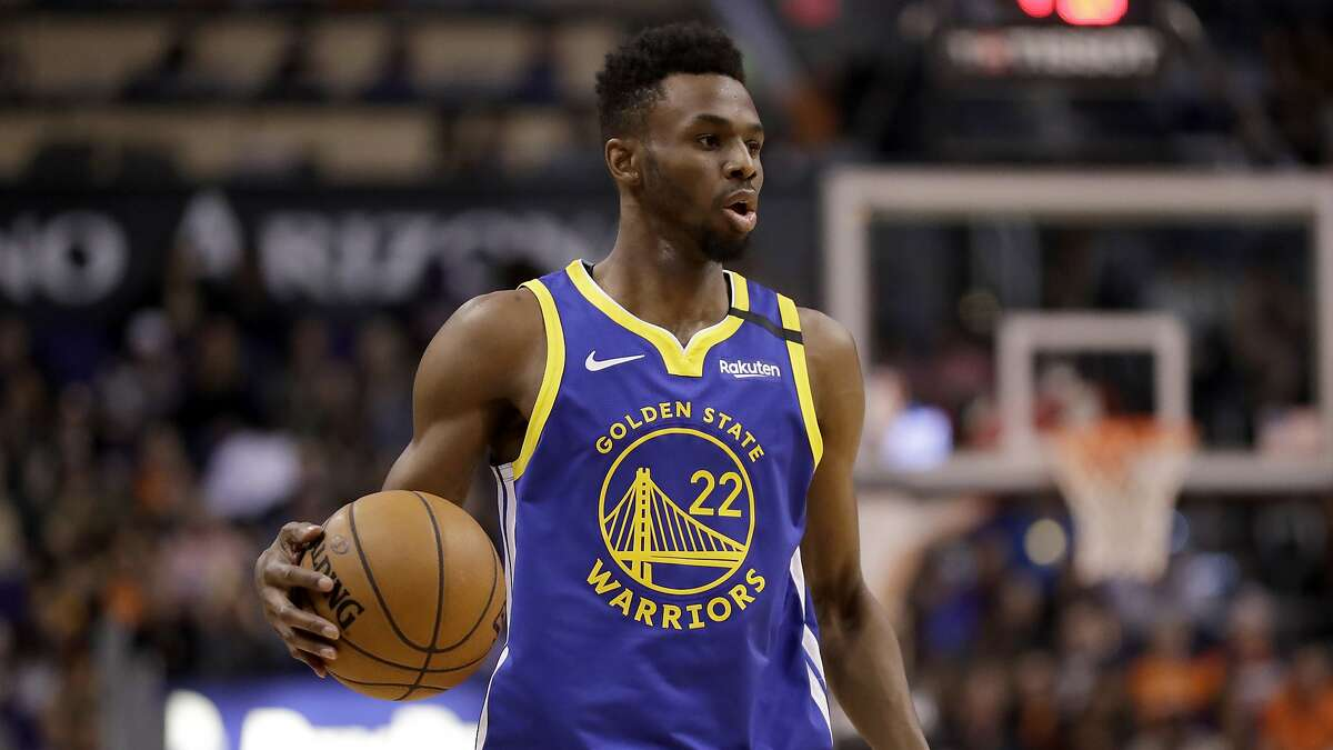 Golden State Warriors guard Andrew Wiggins (22) looks to pass against the Phoenix Suns during the second half of an NBA basketball game, Wednesday, Feb. 12, 2020, in Phoenix. (AP Photo/Matt York)