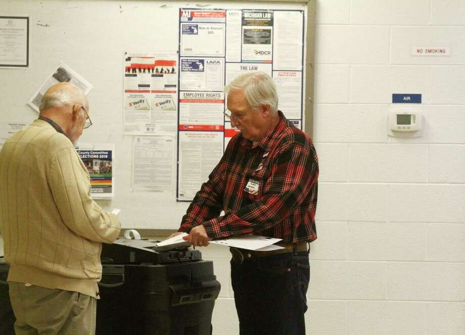 Election inspectors counted ballots during the November election. At the time, the sinking fund proposal was voted down by 64 votes. (Pioneer file photo)