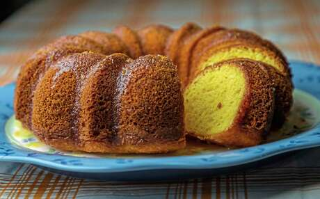 """County Fair Orange Cake from """"Martina's Kitchen Mix"""" by Martina McBride lives up to its name. There is orange juice in the cake batter and in the glaze. She got the recipe from the County Fair in Owensville, Mo., after tasting the cake backstage when she was at the fair for a performance."""