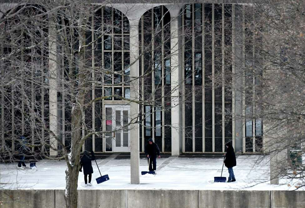 Snow is cleared from Dutch Quad at the University at Albany campus on Tuesday, Feb. 18, 2020, in Albany, N.Y. (Will Waldron/Times Union)