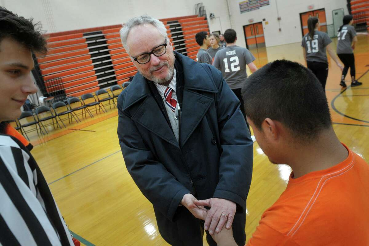 Shelton Superintendent of Schools Chris Clouet greets students prior to a unified sports basketball game at Shelton High School on Tuesday. Clouet has announced he will be leaving his position at the end of the month.