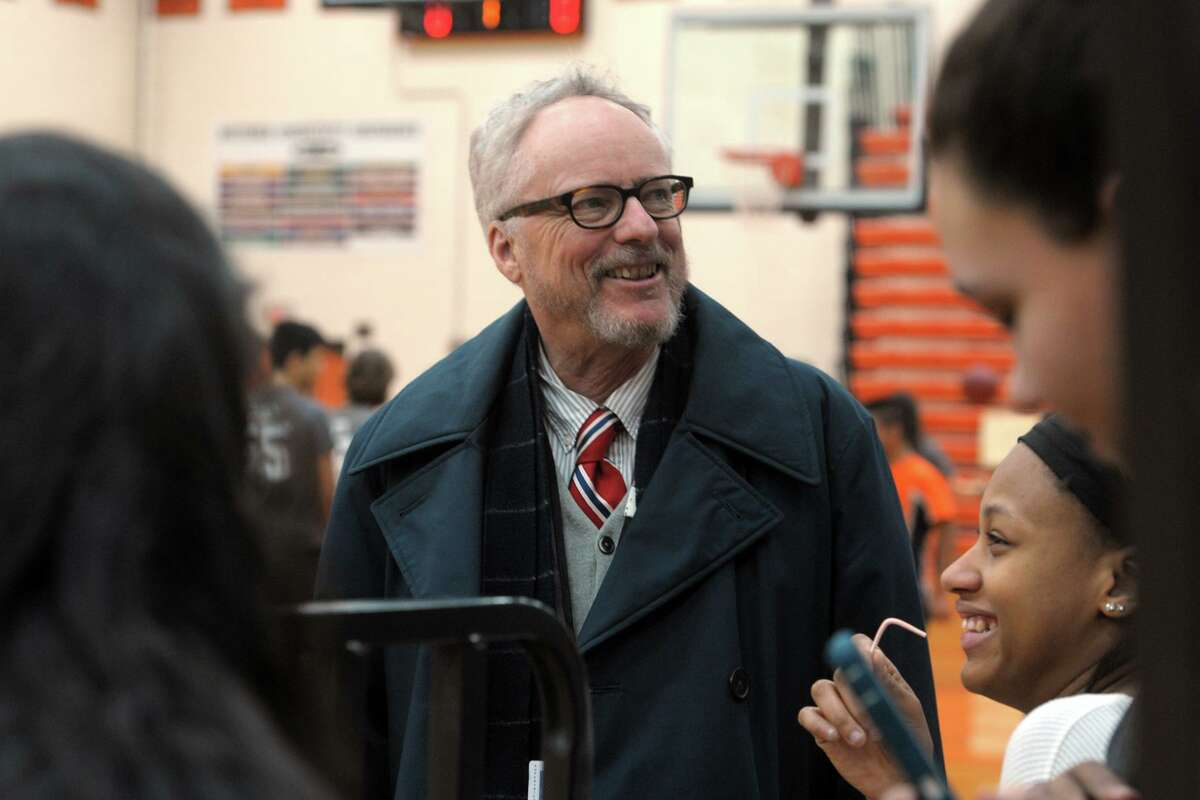 Shelton Superintendent of Schools Chris Clouet speaks with students prior to a unified sports basketball game at Shelton High School on Tuesday. Clout has announced he will be leaving his position at the end of the month.