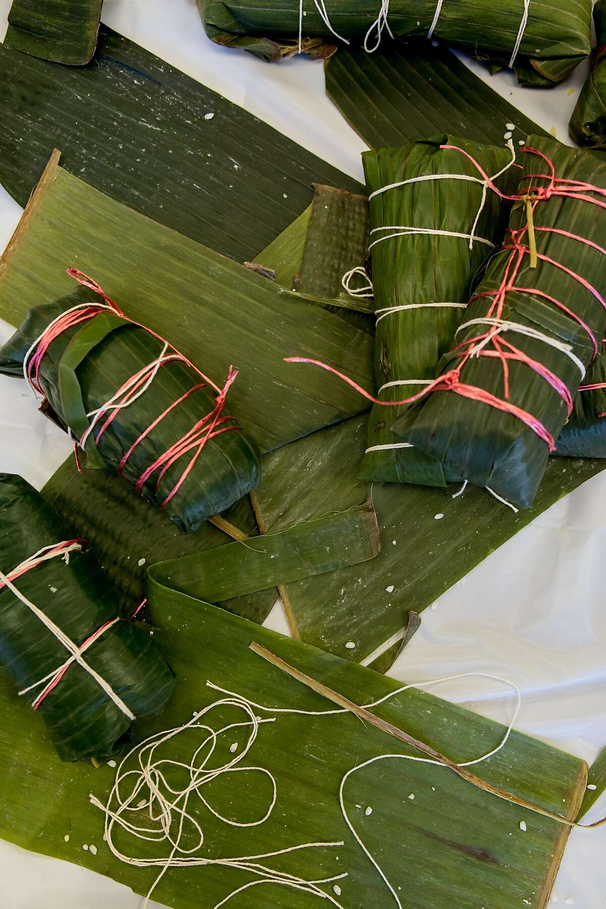 Elders are experts in tying b�nh t�t, a parcel of sticky rice, mung beans, and sweet yams wrapped in banana leaves in San Jose on February 8, 2020.