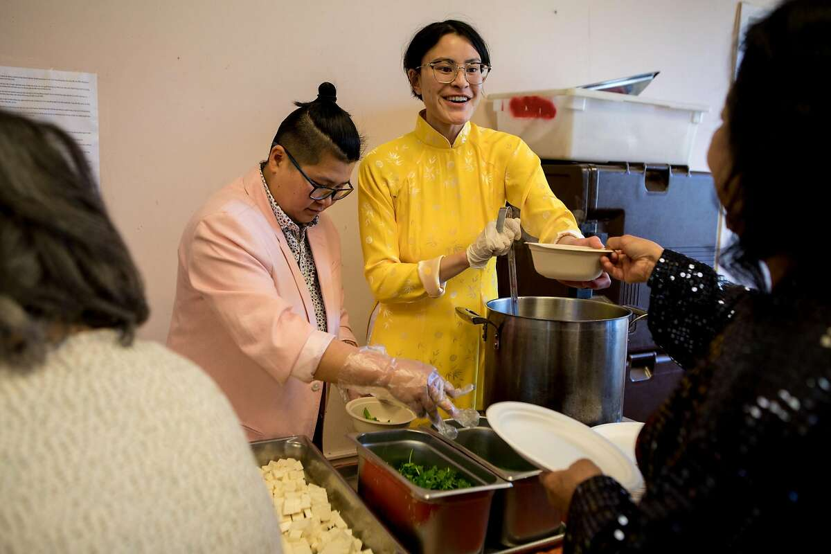 Trang Tran and Jessie Nguyen serve bittermelon soup at the cookhub at the T�t celebration on February 8, 2020 in San Jose, California.