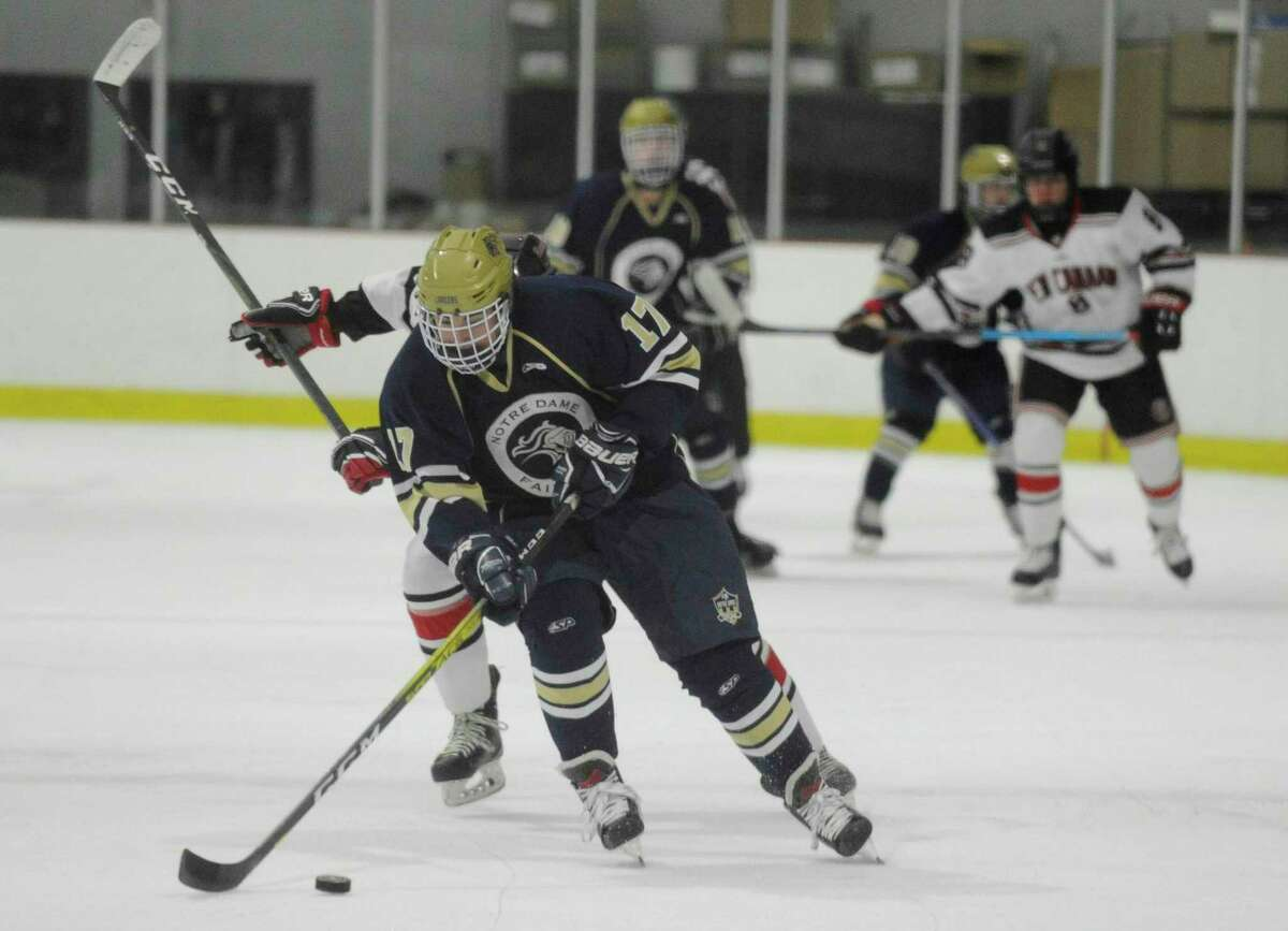 Notre Dame-Fairfield's Mike Ceneri (17) drives the puck against New Canaan in the first period of a boys hockey game at the Darien Ice House on Jan. 4, 2020 in Darien, Connecticut. New Canaan won 3-2 in over-time.