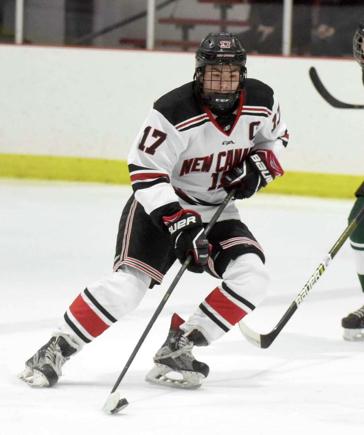 New Canaan's Justin Wietfeldt (17) carries the puck into the zone during the Rams' boys ice hockey game against Northwest Catholic on at the Darien Ice House on Saturday, Jan. 11, 2020.