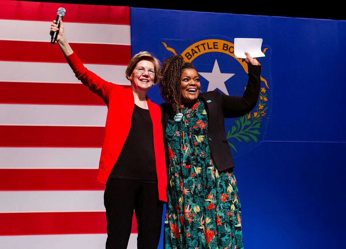 Democratic presidential candidate Sen. Elizabeth Warren, D-Mass., and Yvette Nicole Brown onstage during a campaign event at Centennial High School in Las Vegas on Saturday, Feb. 15, 2020.