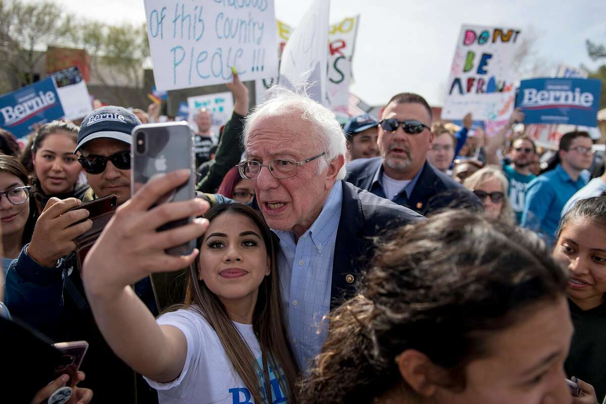 Sen. Bernie Sanders (I-Vt.), a candidate for the Democratic nomination for president, takes photos with attendees during a campaign rally in Las Vegas on Feb. 15, 2020. (Bridget Bennett/The New York Times)