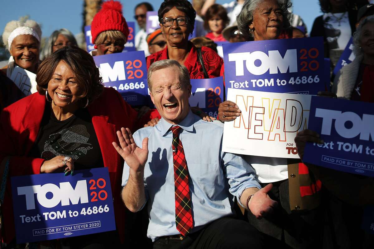 LAS VEGAS, NEVADA - FEBRUARY 14: Democratic presidential candidate Tom Steyer reacts as he poses with supporters during a campaign event at Martin Luther King Jr. Senior Center February 14, 2020 in Las Vegas, Nevada. Steyer continues to campaign for the upcoming Nevada Democratic presidential caucus. (Photo by Alex Wong/Getty Images) *** BESTPIX ***