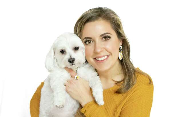 Kara Whiting and her dog Lilly Belle, the namesake of Whiting's company Lilly Belle Jewelry Co.