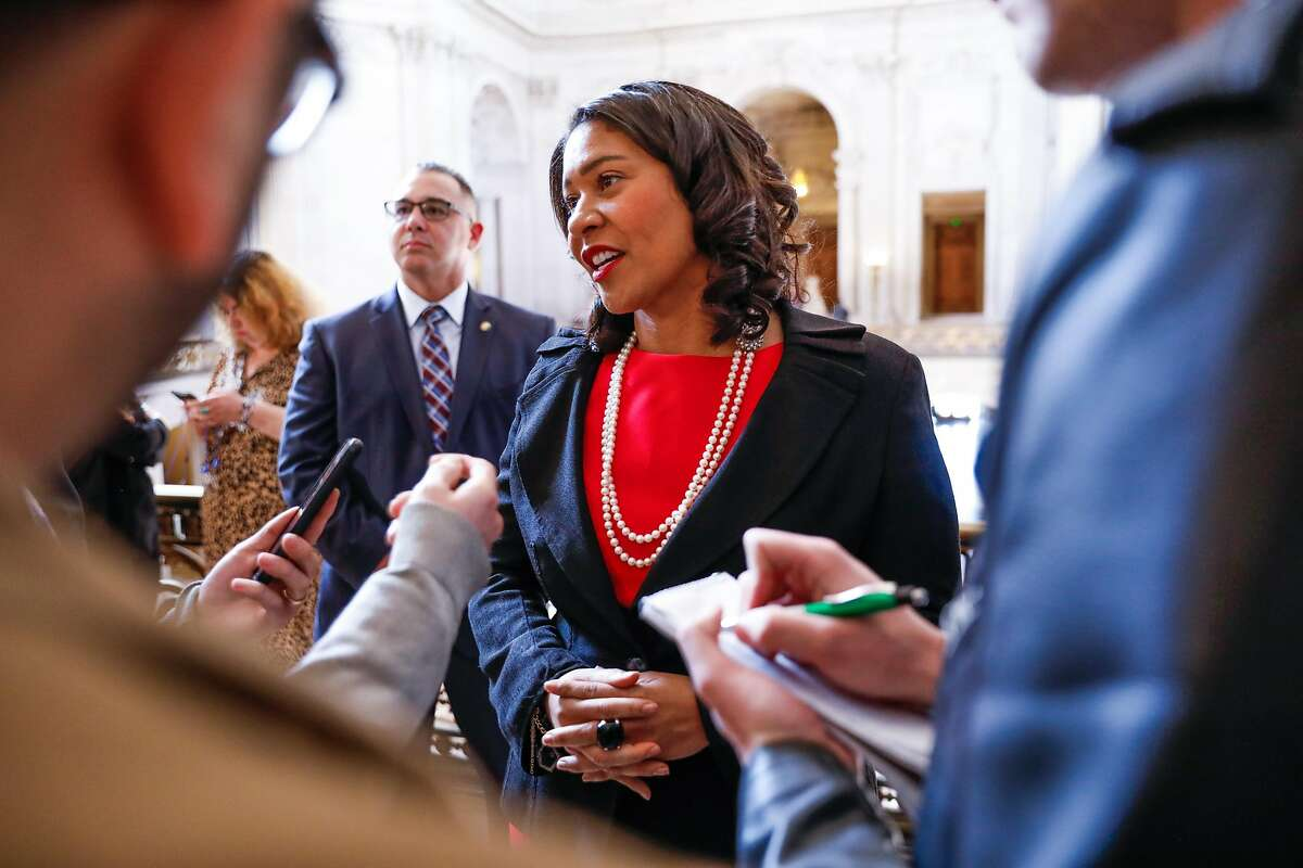 Mayor London Breed (center) answers questions from journalists after a press conference regarding gay pride at City Hall on Tuesday, Feb. 18, 2020 in San Francisco, California.
