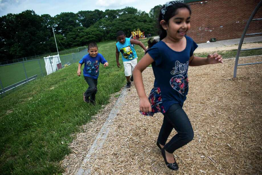 Let kindergartners play and they will learn to love school. If classes are heavily scheduled, school feels like prison. More work and less play isn't the fix for kids who start school behind. Photo: Gabriella Demczuk /New York Times / NYTNS