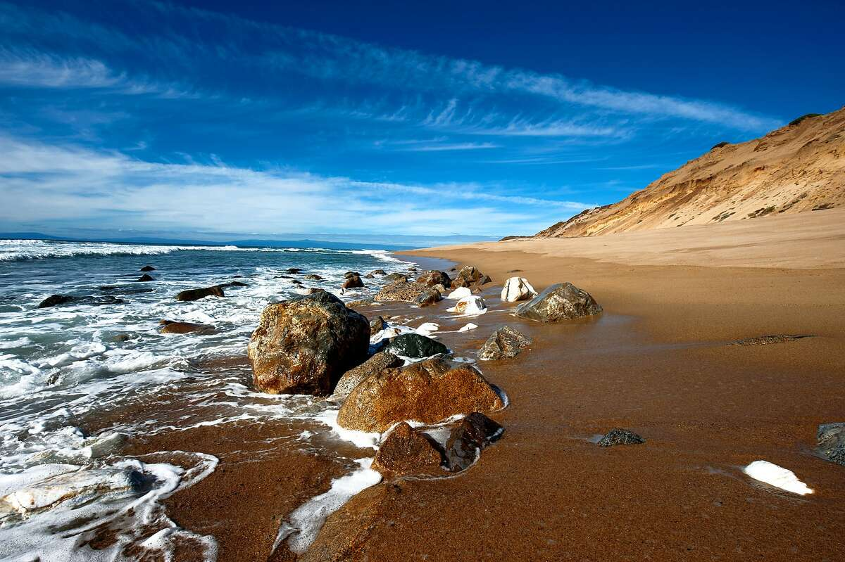 A beach peppered with rocks at Fort Ord Dunes State Park
