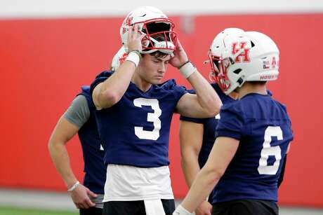 Houston quarterback Clayton Tune (3) takes a break with other quarterbacks during the first day of spring football practice Tuesday, Feb. 18, 2020 at the indoor practice facility on campus in Houston, TX.