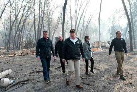 President Donald Trump, shown here touring areas devastated by the 2018 Paradise wildfire, likes to berate California. Yes, people are leaving the state — but not their values.