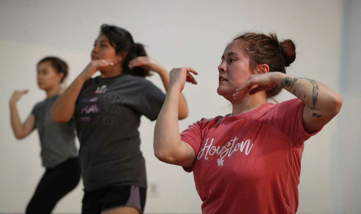 April Mai, left, Clara Cardenas and Kendal Martinez take part in a class at Bollycurves Studio.