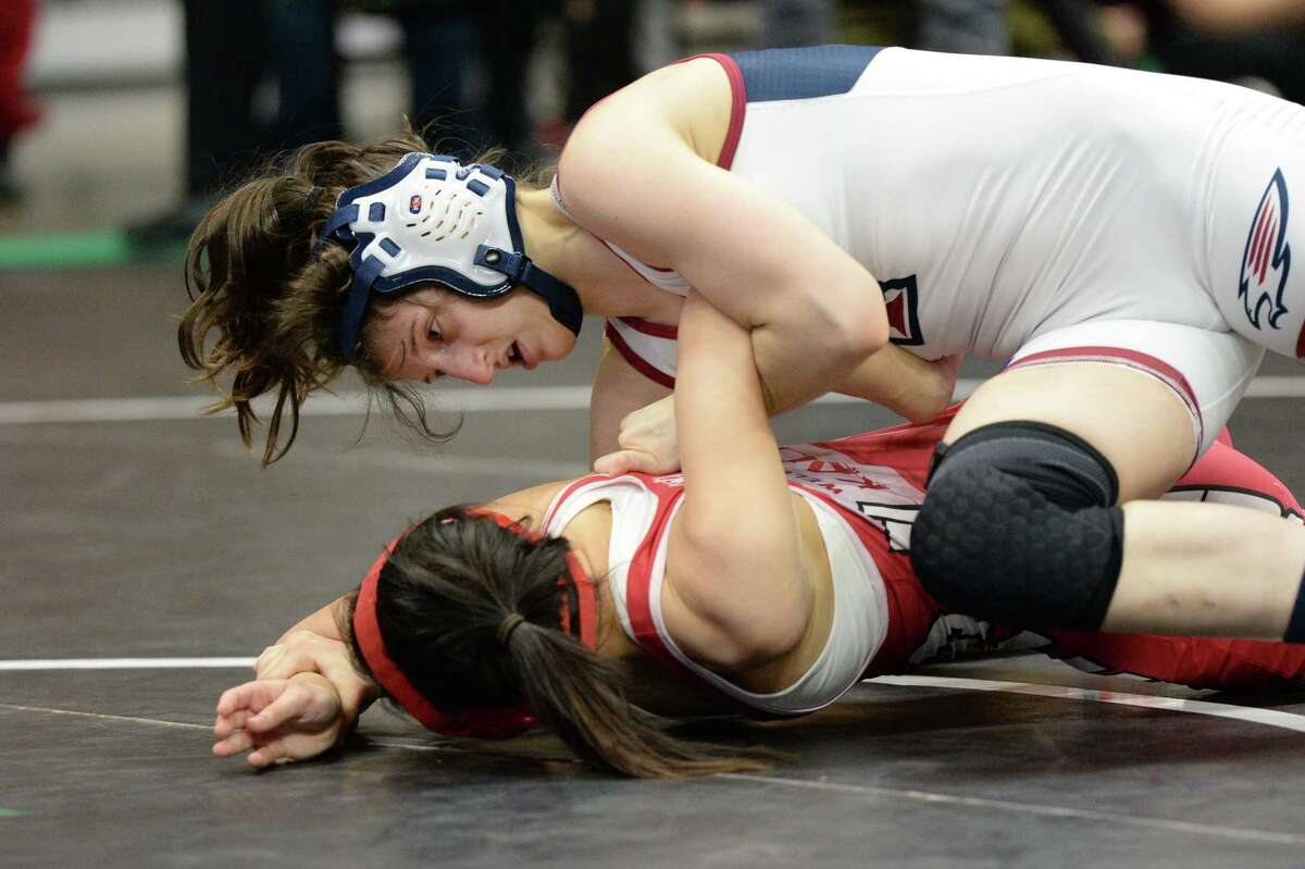 Lilly Broadrick of Katy Tompkins and Djin (Didi) Box of Katy compete in the girls 119 pound weight class during the Region III 6-A UIL Wrestling Championships on Saturday February 15, 2020 at the Leonard Merrell Center, Katy, TX.