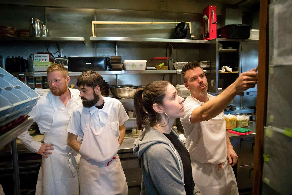 Chef Thomas McNaughton checks in with Benjamin Moeller (Sous Chef at Flour+Water), Amanda Flores (General Manager of Flour+Water), and Ryan Pollnow (Executive Chef of Ne Timeas Restaurant Group) as they oversee the dinner menu at Flour + Water restaurant in San Francisco, Calif., on Wednesday, February 12, 2020. Contemporary Italian restaurant Flour + Water has become one of San Francisco?s most popular restaurants since it opened in 2009. Founders McNaughton and partners went on to found Ne Timeas Restaurant Group, one of roughly two-dozen small, local restaurant groups that have emerged in San Francisco in recent years. These groups are responsible for some of the city's most popular restaurants, managing to endure the steep challenges of opening and keeping afloat a mid-priced to upscale restaurant in San Francisco.