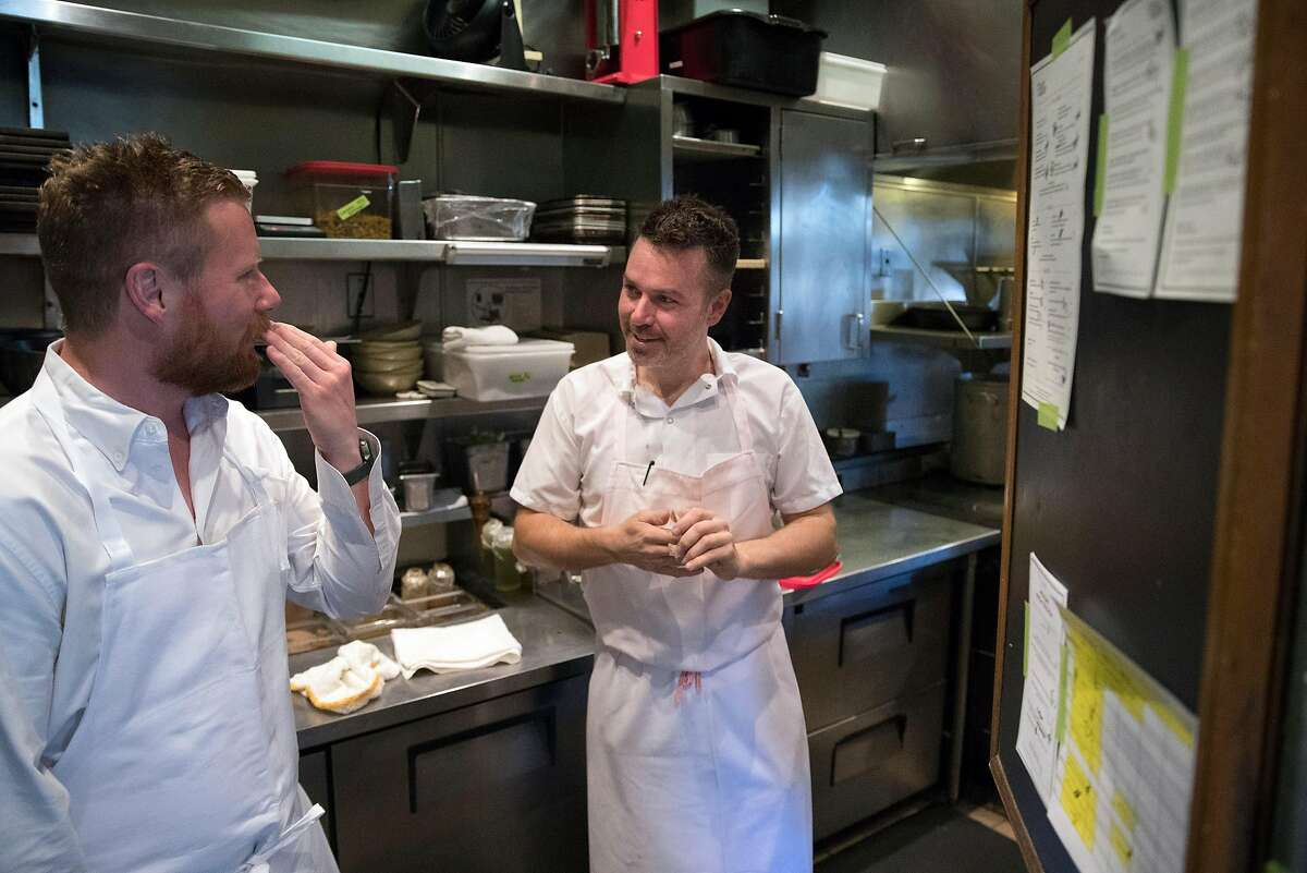 Chef Thomas McNaughton checks in with chef Ryan Pollnow at Flour + Water restaurant in San Francisco, Calif., on Wednesday, February 12, 2020. Contemporary Italian restaurant Flour + Water has become one of San Francisco?s most popular restaurants since it opened in 2009. Founders McNaughton and partners went on to found Ne Timeas Restaurant Group, one of roughly two-dozen small, local restaurant groups that have emerged in San Francisco in recent years. These groups are responsible for some of the city's most popular restaurants, managing to endure the steep challenges of opening and keeping afloat a mid-priced to upscale restaurant in San Francisco.