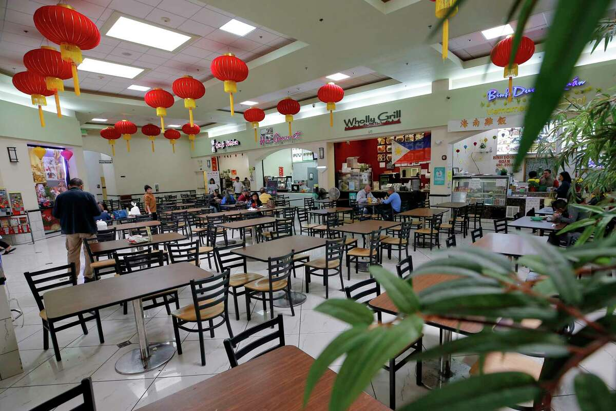 In this Feb. 13, 2020, photo, a sparse lunchtime crowd eats in the food court at Mekong Plaza in the Asian district, in Mesa, Ariz. The Asian district is trying to gain a cultural foothold in the community that previously had little Asian presence but the coronavirus outbreak in China has been impacting business in Mesa and throughout the U.S. (AP Photo/Matt York)