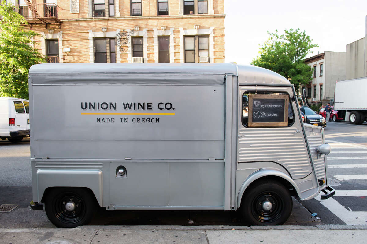 The iconic Union Wine Co. truck parked on the street.